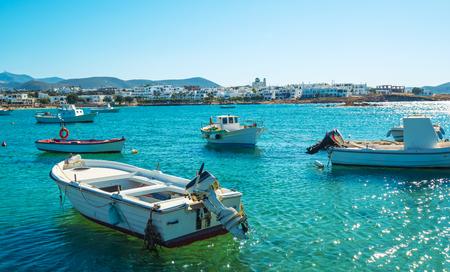 Motor boats near coastline at sunny day