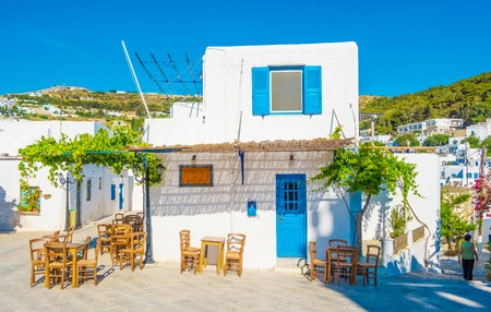 Quiet traditional greek street with white houses Stock Photo