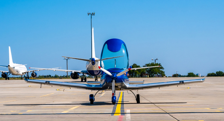 Shiny blue sport plane at the airport  sunshine runway