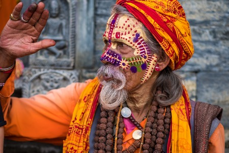 Kathmandu, Nepal - 06 October 2017: sadhu in colourful clothes and painted face in Kathmandu city, Nepal Editorial