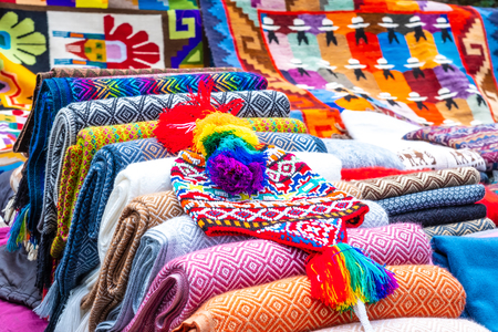 Colorful knitted hat and different blankets with weaving on street souvenir shop in Peru Stok Fotoğraf