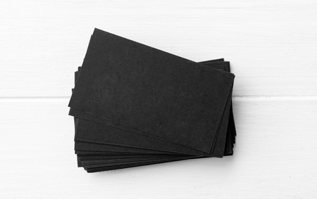 Blank of black business cards stack on white table for your design