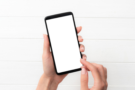 Template of using black smartphone on white table background for your design Stock fotó