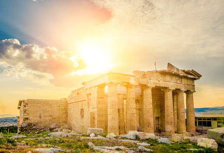 Glowing sun rays illuminate ancient Erechtheum temple ruins, Acropolis, Athens, Greece