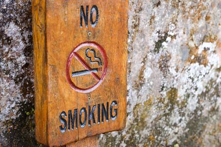 Wooden no smoking sign  of rock in Machu picchu 写真素材