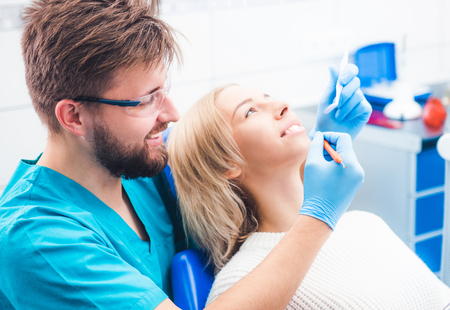 Patient and dentist in the dental office