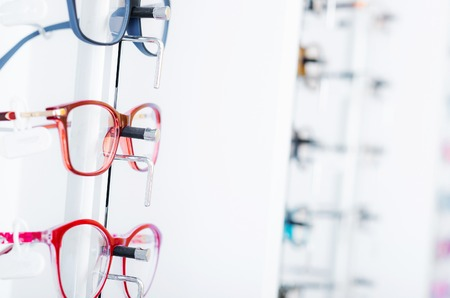 Closeup view of different colorful glasses for kinds on the showcase in the optical store Banque d'images - 123993122