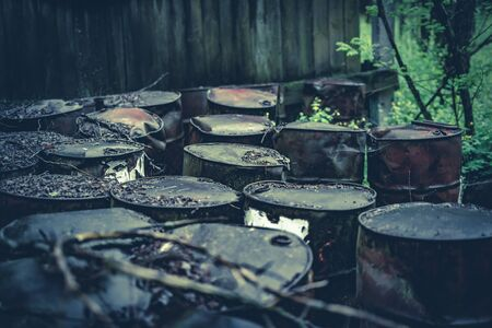 Barrels of chemicals in forest in the Chernobyl exclusion zone. Pripyat Reklamní fotografie