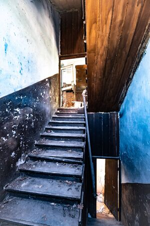 Creepy ruined grunge stairwell in an abandoned hospital