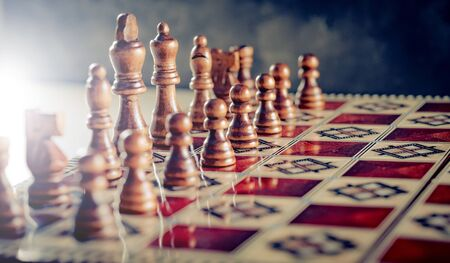 Closeup wooden figures on chess game board