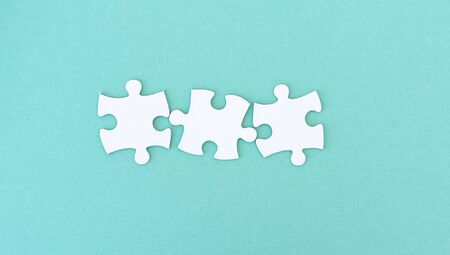 Jigsaw puzzle pieces in a row for inscription, 3 pieces