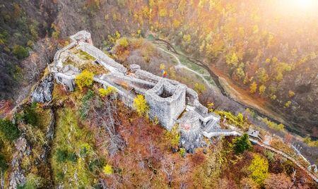 Aerial view of beautiful Poenari Citadel in autumn mountains
