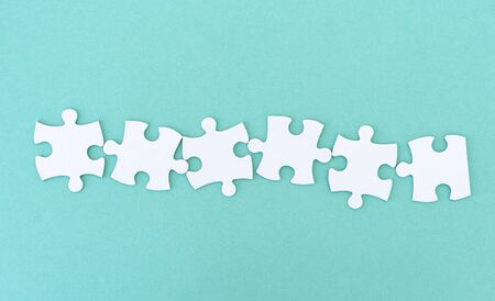 Jigsaw puzzle pieces in a row for inscription, 6 pieces