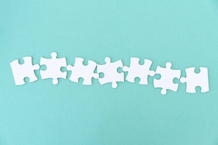 Jigsaw puzzle pieces in a row for inscription, 7 pieces Archivio Fotografico