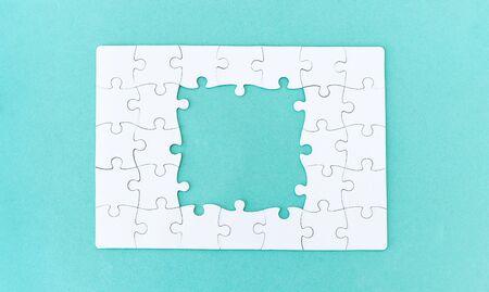 Unfinished jigsaw puzzle on blue background