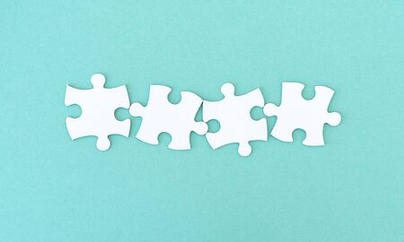 Jigsaw puzzle pieces in a row for inscription, 4 pieces