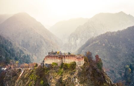 Famous Poenari citadel on background of romania mountains