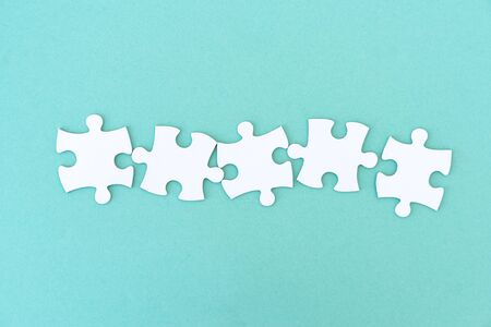 Jigsaw puzzle pieces in a row for inscription, 5 pieces