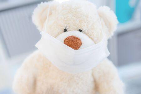Face medical mask on teddy bear