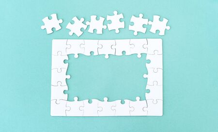 Top view of jigsaw puzzle with pieces for lettering