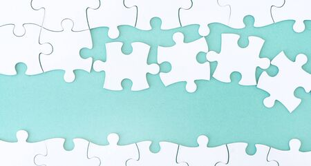 Close up view of mockup puzzle on blue background Archivio Fotografico