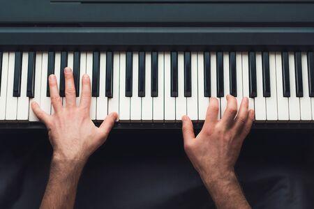 Man playing piano, top view