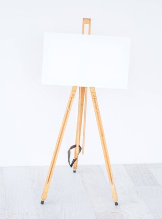 White canvas on easel for template, on white background with copy space
