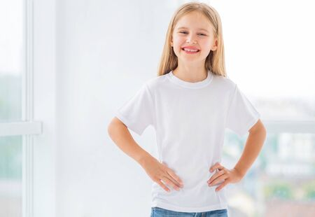 Cute little girl in white t-shirt, blamk for your design