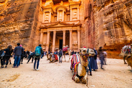 Large interesting tourist complex of the ancient city of Petra with tourists and camals
