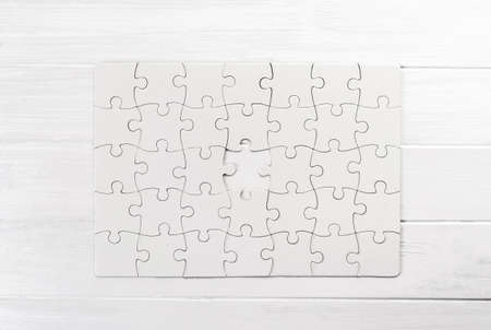 Top view of white jigsaw puzzle