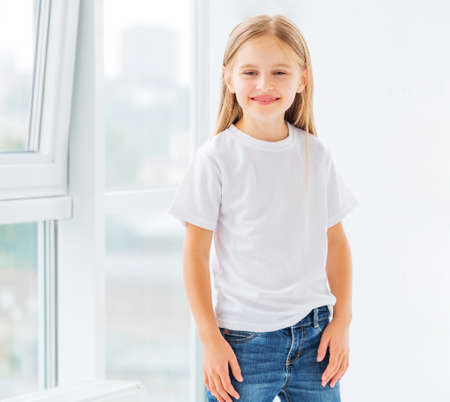 Smiling little girl in simple white blank t-shirt