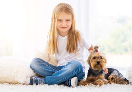 Sweet girlie sitting next to domestic dog