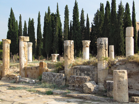 The ruins of an ancient Greek city in the background of hills and green cypresses. Turkey Banco de Imagens