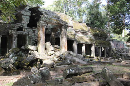 gods: The ruins of a temple in the complex of Angkor, near the ancient city of Siem Reap. Black and gray stones, jungle around
