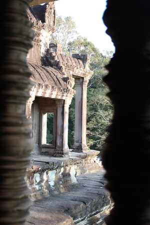 Window of the ancient temple in the complex of Angkor, near the ancient city of Siem Reap.