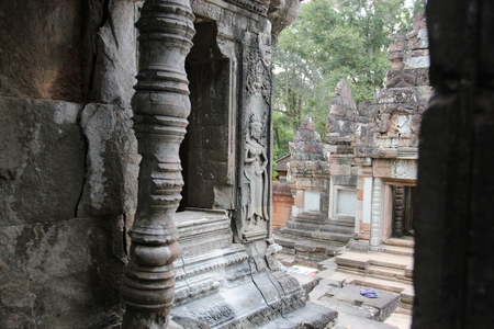 gods: Window of the ancient temple in the complex of Angkor, near the ancient city of Siem Reap.