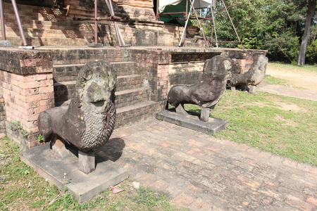 Sculpture on the ruins of a ruined temple in Angkor complex, near the ancient capital of Cambodia - Siem Reap