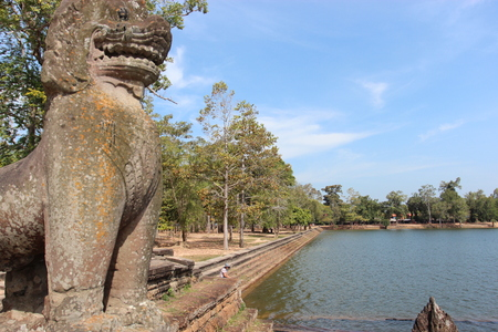 Pond near the ruins of the ancient temple of the temple in the middle of the jungle. Complex Angkor, Cambodia Stock Photo