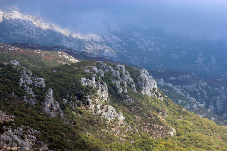 High rocky mountains, cloudy sky. Beautiful panoramic view of the mountainous terrain of Montenegro Stock Photo