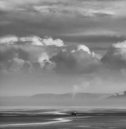 dispose: The easy ripples on water dispose to a pacification.The lonely ship goes under cumulus clouds.