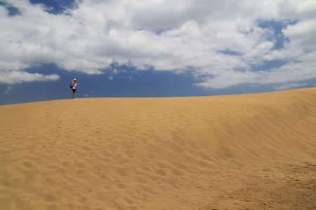 holiday maker: Lonely woman in windy Maspalomas Dune - Desert in  Gran Canaria