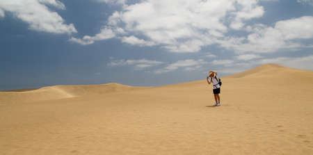 holiday maker: Lonely woman in wit hat Maspalomas Dune - Desert in  Gran Canaria Stock Photo