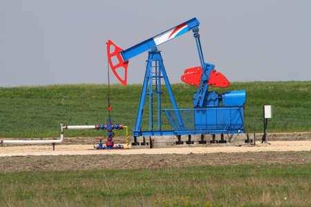 medow: Blue and red oil well on the medow