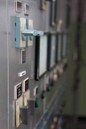 control power: Part of power plant control panel with switches and instruments