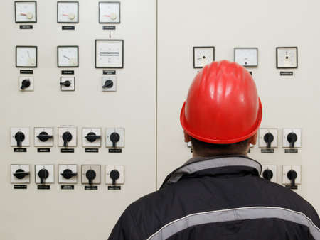control center: Engineer read instruments in power plant control center Stock Photo