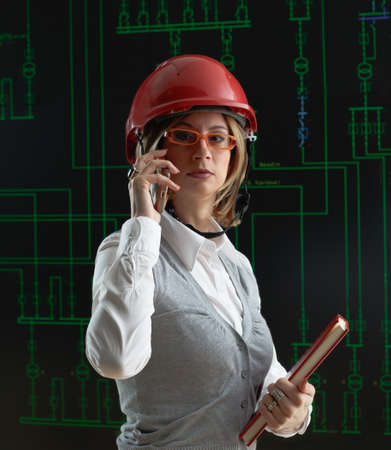 power distribution: Woman with red helmet make call in power distribution control center Stock Photo