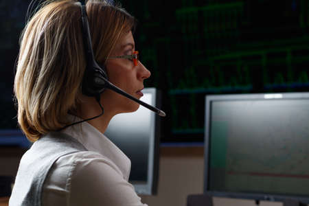 Dispatcher with headphone in power distribution control center Banque d'images