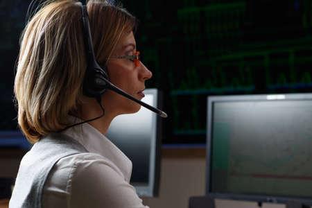 Dispatcher with headphone in power distribution control center Standard-Bild