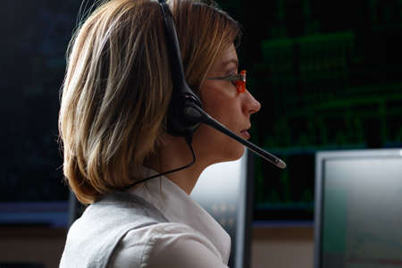 power distribution: Dispatcher with headphone in power distribution control center Stock Photo