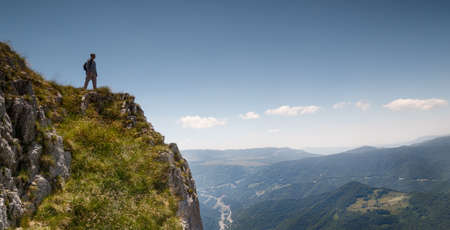 mountaineer: Mountaineer on viewpoint in Sutjeska national park, Bosnia and Herzegovina Stock Photo